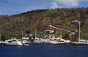 boats in harbor; buildings on hillside shore; island scene; Sopers Hole; Tortola; British Virgin Islands