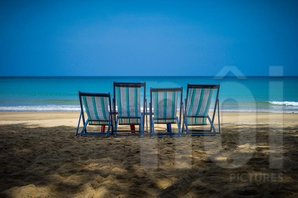 Sun loungers invitingly arranged on Dam Trau beach, Con Dao, Ba Ria - Vung Tau Province, Vietnam, Southeast Asia