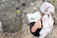 Comic strip artist Isabelle Dethan at work, Palaeontological excavations at Angeac, Charente, France (July 2016) © Rudolf Abraham