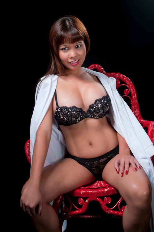 Sensual oriental woman in lingerie and robe.