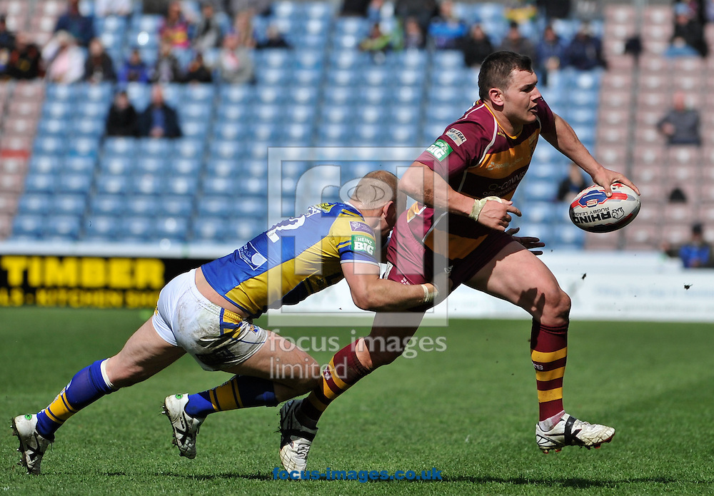 Picture by Richard Land/Focus Images Ltd +44 7713 507003.11/05/2013.Brett Ferres of Huddersfield Giants tries to get on the outside of Carl Ablett of Leeds Rhinos during the Tetley's Challenge Cup match at the John Smiths Stadium, Huddersfield.