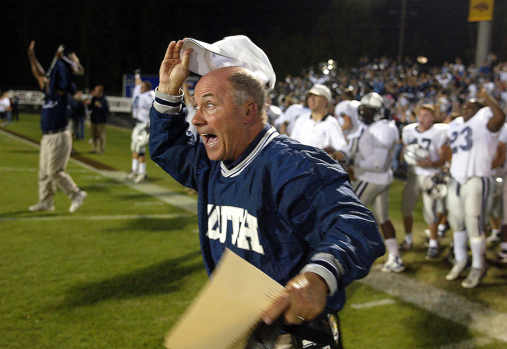 South Gwinnett's head coach T. McFerrin shouts for joy after defeating their arch rival Brookwood in the football playoffs.