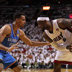Jun 17, 2012; Miam, FL, USA; Miami Heat small forward LeBron James (6) looks to drive against Oklahoma City Thunder shooting guard Thabo Sefolosha (2) during the third quarter in game three in the 2012 NBA Finals at the American Airlines Arena. Mandatory Credit: Derick E. Hingle-US PRESSWIRE