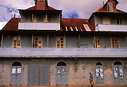 Man walks past traditional building in Victoria, Mahe Island, Seychelles