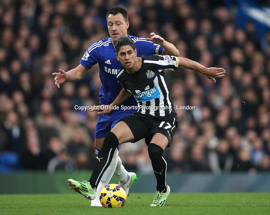10 January 2015 Premier League Football - Chelsea v Newcastle United ;  Ayoze Perez of Newcastle shields the ball from John Terry.<br /> <br /> Photo: Mark Leech