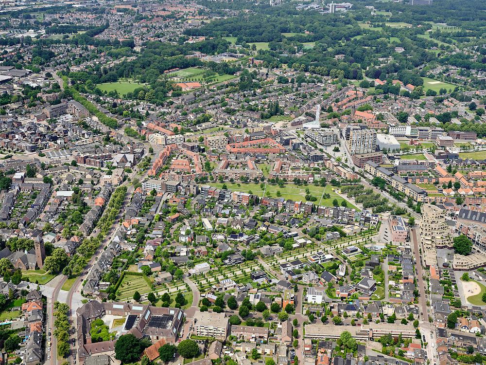Nederland, Overijssel, Gemeente Enschede; 21–06-2020; overzicht van de woonwijk Roombeek, herbouwd na de vuurwerkramp (S.E. Fireworks). <br /> Onder en diagonaal de Museumlaan (een van de drie assen van Roombeek) met in het groen boeven het midden Monument Vuurwerkramp Enschede (Tollensstraat)<br /> Overview of the residential area of Roombeek, rebuilt after the fireworks disaster (S.E. Fireworks).<br /> On the lawn in the middle the Enschede Fireworks Disaster Monument (Tollensstraat)<br /> <br /> luchtfoto (toeslag op standard tarieven);<br /> aerial photo (additional fee required)<br /> copyright © 2020 foto/photo Siebe Swart