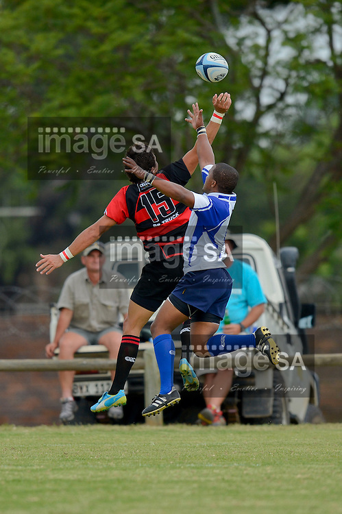 POLOKWANE, SOUTH AFRICA - Saturday 9 March 2013,  during match 30 of the Cell C Community Cup rugby match between BB Truck Noordelikes and Rustenburg Impala held at the Noordelikes Rugby Club, Polokwane. Jermaine Anshon Apollis and Jean-Pierre Vermeulen compete for the ball..Photo by ImageSA