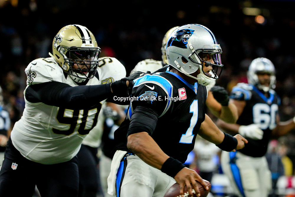 Oct 16, 2016; New Orleans, LA, USA; Carolina Panthers quarterback Cam Newton (1) is pressured by New Orleans Saints defensive tackle Nick Fairley (90) during the third quarter of a game at the Mercedes-Benz Superdome. The Saints defeated the Panthers 41-38. Mandatory Credit: Derick E. Hingle-USA TODAY Sports