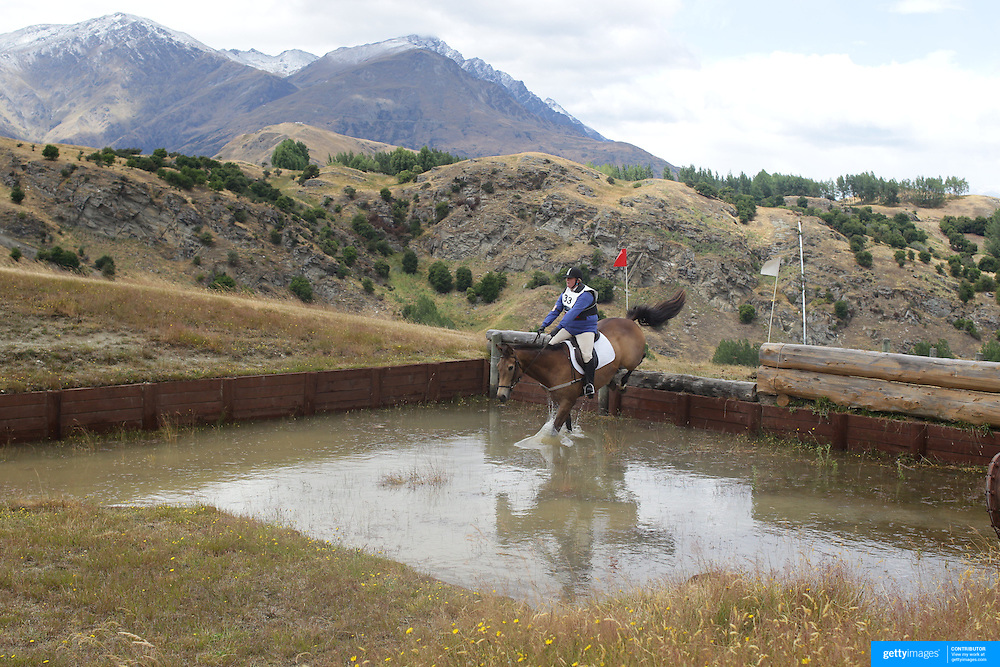 Zara Crutchley riding Just Dusty in action at the water jump during the Cross Country event at the Wakatipu One Day Horse Trials at the Pony Club grounds,  Queenstown, Otago, New Zealand. 15th January 2012. Photo Tim Clayton