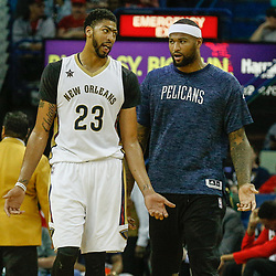 Mar 17, 2017; New Orleans, LA, USA; New Orleans Pelicans forward Anthony Davis (23) talks to forward DeMarcus Cousins during a time out in the second quarter of a game against the Houston Rockets at the Smoothie King Center. Mandatory Credit: Derick E. Hingle-USA TODAY Sports