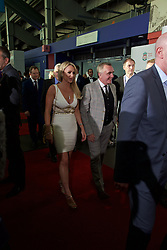 LIVERPOOL, ENGLAND - Tuesday, May 19, 2015: Liverpool's Managing Director Ian Ayre and partner arrive on the red carpet for the Liverpool FC Players' Awards Dinner 2015 at the Liverpool Arena. (Pic by David Rawcliffe/Propaganda)
