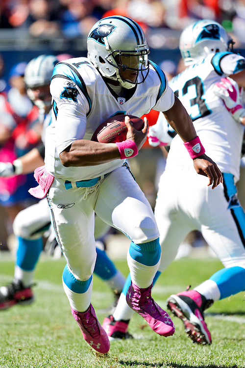 CHICAGO, IL - OCTOBER 2:   Cam Newton #1 of the Carolina Panthers runs the ball against the Chicago Bears at Soldier Field on October 2, 2011 in Chicago, Illinois.  The Bears defeated the Panthers 34 to 29.  (Photo by Wesley Hitt/Getty Images) *** Local Caption *** Cam Newton