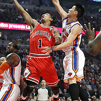 12 March 2012: Chicago Bulls point guard Derrick Rose (1) goes for the layup past New York Knicks point guard Jeremy Lin (17) during the Chicago Bulls 104-99 victory over the New York Knicks at the United Center, Chicago, Illinois, USA.