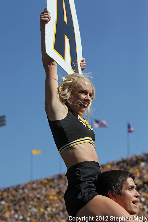 September 29 2012: An Iowa Hawkeyes cheer leader holds up a sign during the second quarter of the NCAA football game between the Minnesota Golden Gophers and the Iowa Hawkeyes at Kinnick Stadium in Iowa City, Iowa on Saturday September 29, 2012. Iowa defeated Minnesota 31-13 to claim the Floyd of Rosedale Trophy.