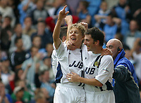 Photo: Jo Caird<br /> Coventry City v Wigan Athletic<br /> Nationwide Football League Div 1<br /> 27/09/2003.<br /> <br /> Jimmy Bullard and Nicky Eaden celebrate Matt Jacksons goal