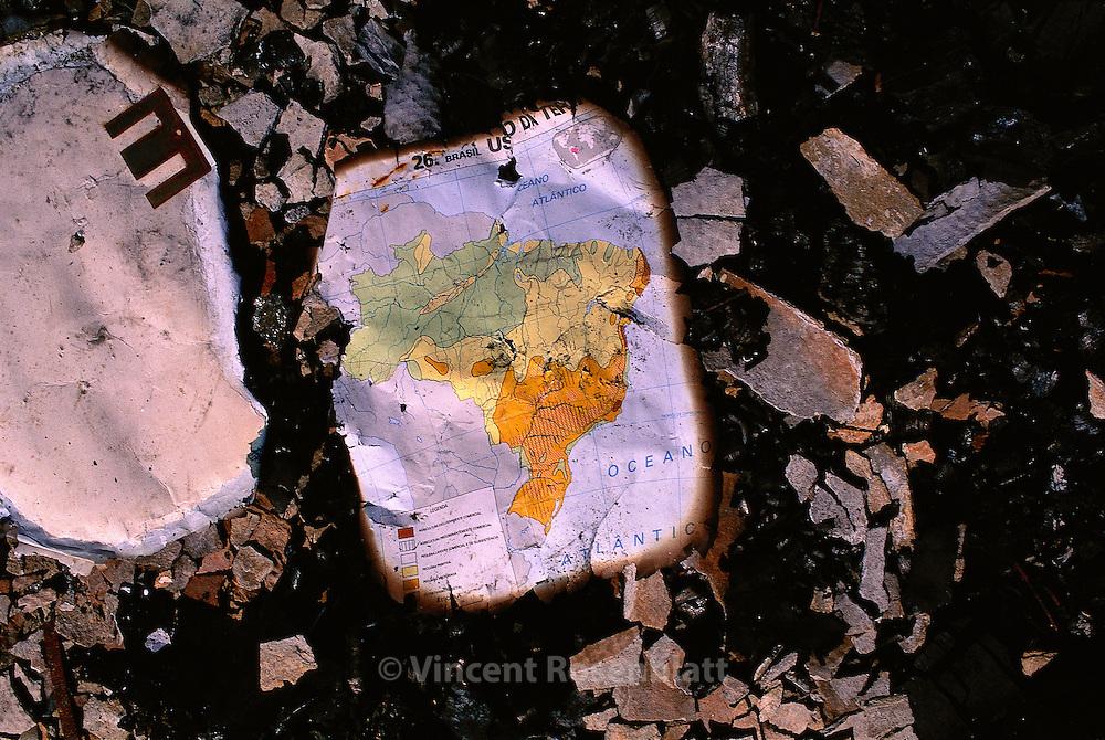 Map of Brazil found within the ashes, after a fire in the favela Mandela, Rio de Janeiro.. ||.Mapa do Brasil, encontrada no chão, depois de um incendio que atingiu parte da favela de Mandela, Rio de Janeiro