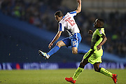 Brighton & Hove Albion winger Jamie Murphy (15) shoots at goal during the EFL Cup match between Brighton and Hove Albion and Reading at the American Express Community Stadium, Brighton and Hove, England on 20 September 2016.