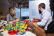 Montana Shrader of Modulus (left) works with a Zoob display during the Silicon Valley Business Journal's HHaaS Tech Mixer at ZERO1 in San Jose, California, on May 28, 2015. (Stan Olszewski/SOSKIphoto for the Silicon Valley Business Journal)