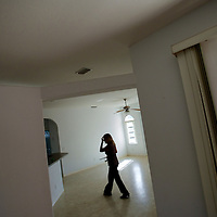 TAMPA, FL -- March 22, 2011 -- Shannon Moore, broker/owner of Green Lion Realty, walks through a vacant home on the market in North Port, Fla., 2011.  A recent study showed that one and five homes in the state of Florida is vacant.