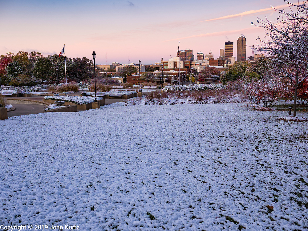 29 OCTOBER 2019 - DES MOINES, IOWA: The Des Moines skyline as seen from the grounds of the Iowa State Capitol with a dusting of snow on the capitol grounds. An unseasonably early dusting of snow, less than 1 inch, blanketed the Des Moines area Tuesday morning. The snow did not accumulate on roads or sidewalks. Des Moines normally gets its first accumulation of snow in mid-November. More snow is expected later this week.               PHOTO BY JACK KURTZ