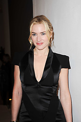 KATE WINSLET at a party to celebrate Lancome's 10th anniversary of sponsorship of the BAFTA's in association with Harper's Bazaar magazine held at St.Martin's Lane Hotel, London on 19th February 2010.