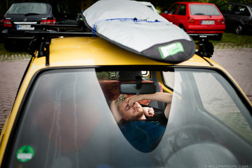 Michael wakes up in his team's car at Zeeburg campsite in Amsterdam, Netherlands a week before the official launch of the 2009 Mongol Rally.