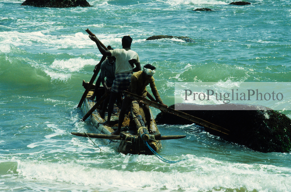 Surronded by the emerald-colored sea fishermen are making their way back to the mainland.