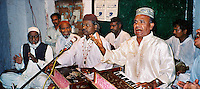 Pakistan, Karachi, 2004. Qawwal means ?utterance,? in Urdu. In this uniquely passionate form of religious music, it is believed that the singer can channel the words of God through his voice.