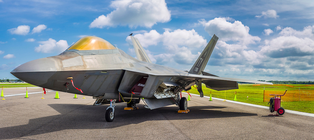 Panoramic image of an F-22 Raptor (and crow), created from two separate exposures and then merged together.  Lakeland, Florida.  <br /> <br /> Created by aviation photographer John Slemp of Aerographs Aviation Photography. Clients include Goodyear Aviation Tires, Phillips 66 Aviation Fuels, Smithsonian Air & Space magazine, and The Lindbergh Foundation.  Specialising in high end commercial aviation photography and the supply of aviation stock photography for advertising, corporate, and editorial use.