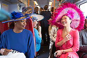 UNITED KINGDOM, London: 14 June 2016 Racegoers enjoy a chat as they head to Royal Ascot on the train for the first day of the annual horse racing event. Rick Findler / Story Picture Agency