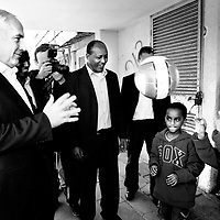 Benjamin Netanyahu plays with Ethiopian immigrant children during a tour to area that were attacked by Hamas rockets in Ashdod, January 2009.
