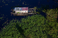 A floating house on the shores of the Amazon River near Manaus, Brazil. <br /> Picture date Wednesday 25th January, 2017.<br /> Picture by Christopher Ison. Contact +447544 044177 chris@christopherison.com