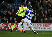 Queens Park Rangers defender Grant Hall (4) and Brighton striker (on loan from Manchester United), James Wilson (21) during the Sky Bet Championship match between Queens Park Rangers and Brighton and Hove Albion at the Loftus Road Stadium, London, England on 15 December 2015.