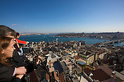 Istanbul. Galata Tower. Visitors enjoying the view from the terrace: Galata Bridge across the Golden Horn, U?sku?dar on the Asian side in backgr. r.