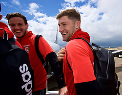 CARDIFF, WALES - Saturday, June 10, 2017: Wales' goalkeeper Daniel Ward and Ben Davies joke as they board the team plane as the squad depart Cardiff Tesla Airport to travel to Belgrade ahead of the 2018 FIFA World Cup Qualifying Group D match against Serbia. (Pic by David Rawcliffe/Propaganda)