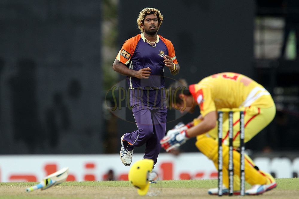 Lasith Malinga tends to Rilee Rossouw after he was hit by a delivery during match 17 of the Sri Lankan Premier League between Basnahira Cricket Dundee and Ruhuna Royals held at the Premadasa Stadium in Colombo, Sri Lanka on the 25th August 2012. .Photo by Ron Gaunt/SPORTZPICS/SLPL