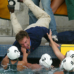 Walnut: Temple City High School waterpolo coach Brian Roth,28, of Monrovia is pulled into the water after the girls beat St Lucy's 6-4 in the CIF Division III girls waterpolo semifinals at Mt. Sac in Walnut,Calif., February 26,2003.<br /> (Pasadena Star-News Staff Photo Keith Birmingham/Sports)