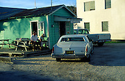 American car outside small shop, George Town, Grand Cayman, Cayman Islands, British West Indies,