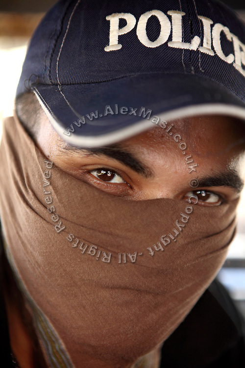 A member of the AVCC (Anti-Violence Crime Cell) is portrayed while at their headquarters in Karachi, Pakistan. The AVCC is a special police unit mostly involved in anti-terrorism operations and kidnap cases in the city and its vicinity.