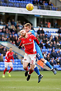Charlton midfielder Jonathan Williams (21) is fouled by Peterborough Utd midfielder Louis Reed (11) during the EFL Sky Bet League 1 match between Peterborough United and Charlton Athletic at London Road, Peterborough, England on 26 January 2019.