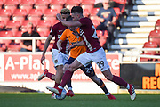 Oldham Athletic midfielder Jack Byrne (29) is tackled by Northampton Town midfielder (on loan from Swansea) Matt Grimes (29) and Northampton Town midfielder Shaun McWilliams (17) during the EFL Sky Bet League 1 match between Northampton Town and Oldham Athletic at Sixfields Stadium, Northampton, England on 5 May 2018. Picture by Dennis Goodwin.