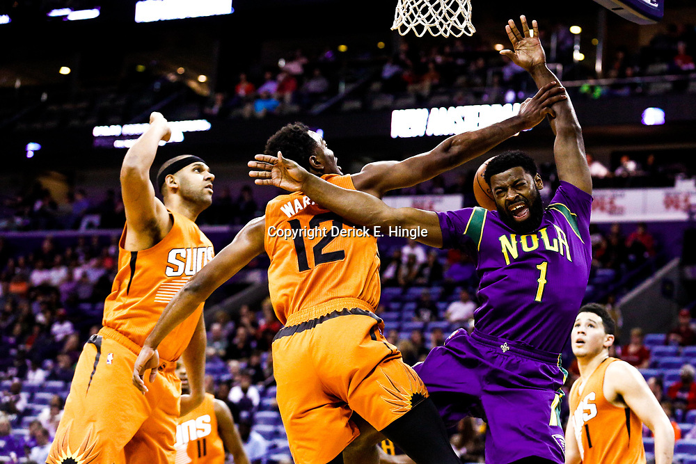 Feb 6, 2017; New Orleans, LA, USA; New Orleans Pelicans guard Tyreke Evans (1) has a shot blocked by Phoenix Suns forward TJ Warren (12) during the first quarter of a game at the Smoothie King Center. Mandatory Credit: Derick E. Hingle-USA TODAY Sports