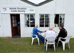 © Licensed to London News Pictures.14/07/15<br /> Harrogate, UK. <br /> <br /> Farmers sit outside a cafe on the opening day of the Great Yorkshire Show.  <br /> <br /> England's premier agricultural show opened it's gates today for the start of three days of showcasing the best in British farming and the countryside.<br /> <br /> The event, which attracts over 130,000 visitors each year displays the cream of the country's livestock and offers numerous displays and events giving the chance for visitors to see many different countryside activities.<br /> <br /> Photo credit : Ian Forsyth/LNP
