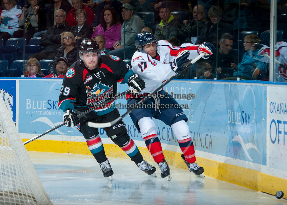 KELOWNA, CANADA, OCTOBER 16 - Myles Bell #29 of the Kelowna Rockets checks Jamal Watson #17 of the Lethbridge Hurricanes on Wednesday, October 16, 2013 at Prospera Place in Kelowna, British Columbia (photo by Marissa Baecker/Getty Images)***Local Caption***