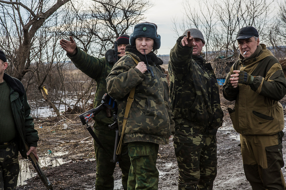 GORLOVKA, UKRAINE - JANUARY 31, 2015: Ira, center, and other rebel fighters discuss recent fighting at a front-line position in Gorlovka, Ukraine. Fighting in Ukraine has intensified over the last week, with rebels declaring the end of a September ceasefire. CREDIT: Brendan Hoffman for The New York Times