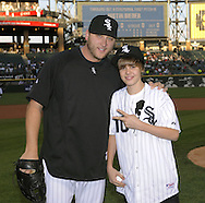 CHICAGO - MAY 03:  Pop music star Justin Bieber poses for a photo with White Sox pitcher Mark Buehrle after throwing out a ceremonial first pitch prior to the game between the Chicago White Sox and Kansas City Royals on May 03, 2010 at U.S. Cellular Field in Chicago, Illinois.  (Photo by Ron Vesely)