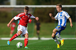 Ben Withey of Bristol City U18 is challenged by Jordan Drew of Brighton U18 - Photo mandatory by-line: Rogan Thomson/JMP - Tel: 07966 386802 - 05/10/2013 - SPORT - FOOTBALL - SGS Wise Campus, Bristol - Bristol City U18 v Brighton & Hove Albion U18 - U18 Professional Development League 2.