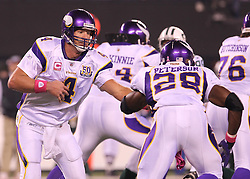 Oct 11, 2010; East Rutherford, NJ, USA; Minnesota Vikings quarterback Brett Favre (4) hands the ball to Minnesota Vikings running back Adrian Peterson (28) during the first half of their game against the New York Jets at the New Meadowlands Stadium.