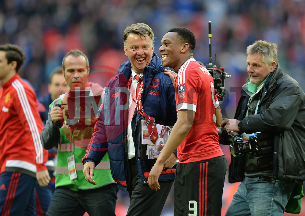 Manchester United Manager Louis van Gaal and Anthony Martial of Manchester United laugh together at full time. - Mandatory by-line: Alex James/JMP - 23/04/2016 - FOOTBALL - Wembley Stadium - London, England - Everton v Manchester United - The Emirates FA Cup Semi-Final