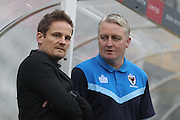AFC Wimbledon manager Neal Ardley and Alan Reeves during The FA Cup match between Sutton United and AFC Wimbledon at Gander Green Lane, Sutton, United Kingdom on 7 January 2017. Photo by Stuart Butcher.
